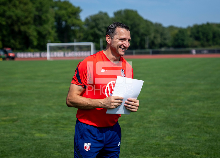 CLEVELAND, OH - SEPTEMBER 14: Vlatko Andonovski of the United States talks to his team after a training session at the training fields on September 14, 2021 in Cleveland, Ohio.