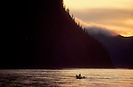 Alaska, Yukon River, Yukon Charley National Preserve, National Park ranger moving upstream between the towns of Eagle and Circle, sunset, Ranger is Bill Berg.