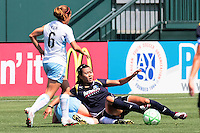 Han Duan #8 of the Los Angeles Sol slides to win a ball against the Chicago Red Stars during their WPS game at The Home Depot Center on June 27,2009 in Carson, California.  The Sol defeated the Red Stars 4-0.