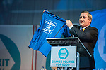 Brexit Party EU elections campaign launch at  The Neon in Newport, South Wales. Brexit Party candidate James Wells shows off his March to Leave tee shirt to delegates.