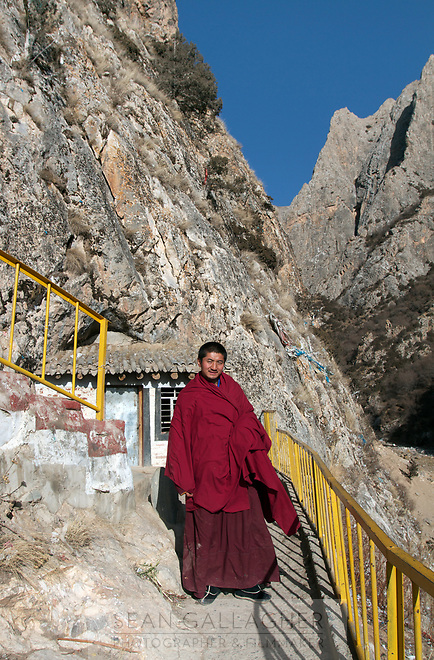 A Tibetan monk in the mountains of the Qinghai-Tibetan Plateau. China.