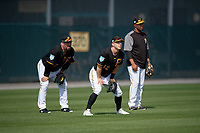 Pittsburgh Pirates outfielder Corey Dickerson (12) waits for a fly ball as Garth Brooks (left) and coach Kimera Bartee (18) look on during the teams first Spring Training practice on February 18, 2019 at Pirate City in Bradenton, Florida.  (Mike Janes/Four Seam Images)