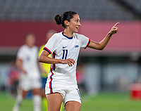 TOKYO, JAPAN - JULY 21: Christen Press #11 of the USWNT talks to a teammate during a game between Sweden and USWNT at Tokyo Stadium on July 21, 2021 in Tokyo, Japan.