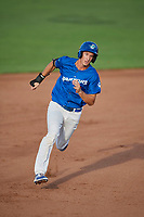 Mitchell Hansen (11) of the Ogden Raptors hustles to third base against the Idaho Falls Chukars at Lindquist Field on August 28, 2017 in Ogden, Utah. Ogden defeated Idaho Falls 7-1. (Stephen Smith/Four Seam Images)