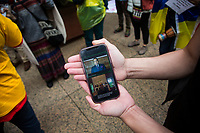 NEW YORK, NEW YORK - MAY 5: A person holds a phone while Colombians gather outside the New York university as Former president Alvaro Uribe offers a virtual talk at the University of New York in Manhattan New York on May 5, 2021. New York. Violent clashes between protesters and riot police in Colombia continue after President Iván Duque ordered Congress to withdraw his tax reform law on Sunday. The international community reported that at least 19 people died, there are more than 846 injured and there are also missing people. (Photo by Pablo Monsalve / VIEWpress via Getty Images)