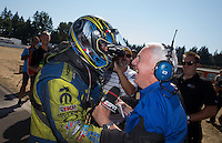 Aug. 4, 2013; Kent, WA, USA: NHRA funny car driver Matt Hagan celebrates with ESPN announcer Gary Gerould after winning the Northwest Nationals at Pacific Raceways. Mandatory Credit: Mark J. Rebilas-USA TODAY Sports