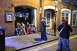 """© Joel Goodman - 07973 332324 . 16/12/2016 . Manchester , UK . Street flower sellers on Canal Street in Manchester's Gay Village . Revellers out in Manchester City Centre overnight during """" Mad Friday """" , named for being one of the busiest nights of the year for the emergency services in the UK . Photo credit : Joel Goodman"""