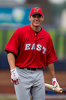 Derek Dietrich (32) of the Bowling Green Hot Rods smiles at a teammate during the Midwest League All-Star Home Run Derby at Modern Woodmen Park on June 20, 2011 in Davenport, Iowa. (David Welker / Four Seam Images)
