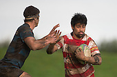 Tenina Sauileoge tries to fend off Nathan Sunde. Counties Manukau Premier Club Rugby game between Karaka and Onewhero, played at Karaka on Saturday June 25th 2016. Karaka won the game 15 - 10 after leading 10 - 3 at halftime.<br />  Photo by Richard Sprnger.
