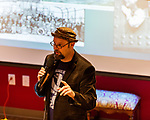"""July 26, 2017. Raleigh, North Carolina.<br /> <br /> Alan Gratz showed some of the photos that inspired the stories in his new book """"Refugee"""".<br /> <br /> Author Alan Gratz spoke about and signed his new book """"Refugee"""" at Quail Ridge Books. The young adult fiction novel contrasts the stories of three refugees from different time periods, a Jewish boy in 1930's Germany , a Cuban girl in 1994 and a Syrian boy in 2015."""