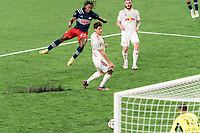 FOXBOROUGH, MA - MAY 22: DeJuan Jones #24 of New England Revolution takes a shot during a game between New York Red Bulls and New England Revolution at Gillette Stadium on May 22, 2021 in Foxborough, Massachusetts.