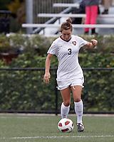 Harvard University midfielder Meg Casscells-Hamby (3) passes the ball. In overtime, Harvard University defeated Yale University,1-0, at Soldiers Field Soccer Stadium, on September 29, 2012.