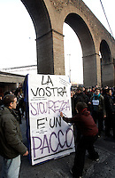 """Manifestazione contro il """"pacchetto sicurezza"""" a Roma, 31 gennaio 2009..Demonstration against the government proposed set of laws on social security, in Rome, 31 january 2009. The sign on the box reads """"Your security is a pack""""..UPDATE IMAGES PRESS/Riccardo De Luca"""
