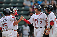 Left fielder Trenton Kemp (17) of the Greenville Drive is congratulated after hitting a home run in a game against the Charleston RiverDogs on Tuesday, May 17, 2016, at Fluor Field at the West End in Greenville, South Carolina. Greenville won, 4-2. (Tom Priddy/Four Seam Images)