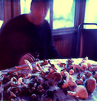 Blurred man and mushrooms at the table<br />