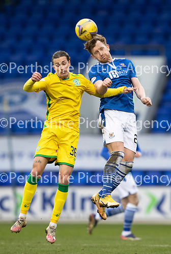 St Johnstone v Hibs …06.03.21   McDiarmid Park   SPFL<br />Liam Craig and Jackson Irvine<br />Picture by Graeme Hart.<br />Copyright Perthshire Picture Agency<br />Tel: 01738 623350  Mobile: 07990 594431