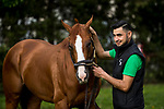 LOUISVILLE, KY - MAY 02: Good Magic with groom Elmer Abrago at Churchill Downs on May 2, 2018 in Louisville, Kentucky. (Photo by Alex Evers/Eclipse Sportswire/Getty Images)