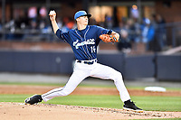 Asheville Tourists starting pitcher Ryan Feltner (14) delivers a pitch during a game against the Augusta GreenJackets at McCormick Field on April 4, 2019 in Asheville, North Carolina. The GreenJackets defeated the Tourists 9-5. (Tony Farlow/Four Seam Images)