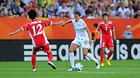 Carli Lloyd (r) of Team USA and Jon Myong Hwa of Team North Korea during the FIFA Women's World Cup at the FIFA Stadium in Dresden, Germany on June 28th, 2011.
