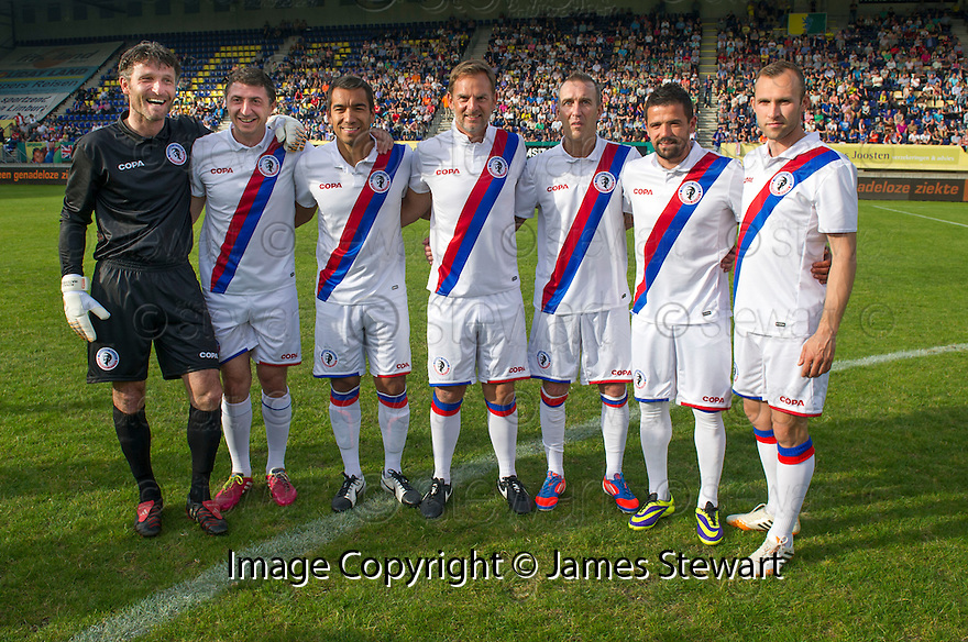Fernando Ricksen Testimonial : Fernando Ricksen (3rd right) lines up with former Rangers' players Ronald Waterreus, Shota Arvladze, Giovanni Van Bronkhorst, Ronald De Boer, Nacho Novo and Thomas Buffel.