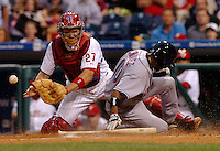 New York Mets Endy Chavez, right, slides safely into home plate as his teammate Lastings Milledge hits an RBI double off Philadelphia Phillies starting pitcher Brett Meyers in the first inning of MLB game Wednesday, June, 14, 2006 in Philadelphia. Phillies catcher Chris Coste can't handle the late throw to the plate. (Newsday/Bradley C Bower)