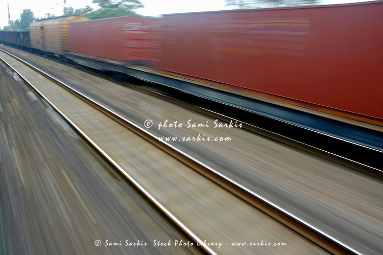 Blurry carriages of a freight train travelling at high speed, China.