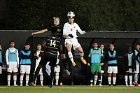 WINSTON-SALEM, NC - NOVEMBER 24: Justin Gielen #9 of the University of Maryland beats Holland Rula #4 of Wake Forest University to a header during a game between Maryland and Wake Forest at W. Dennie Spry Stadium on November 24, 2019 in Winston-Salem, North Carolina.