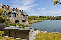 BNPS.co.uk (01202 558833)<br /> Pic: Savills/BNPS<br /> <br /> A former tidal mill next to an impressive viaduct that looks like the perfect backdrop for a children's book is on the market for £3.5m.<br /> <br /> The Old Mill is over 600 years old and would be an ideal home for Swallows and Amazons or The Railway Children-inspired adventures.<br /> <br /> The impressive Grade II listed six-bedroom house has its own private harbour and panoramic views of the much-photographed Forder Railway Viaduct.<br /> <br /> It is only the second time the property in Cornwall has been on the market since 1886 and agents Savills say it is a once in a lifetime opportunity.