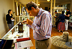 Country House Auction at Newnham Hall Northamptonshire 1994. Antique dealer examines a miniature at the Chritsies auction 1990s UK.