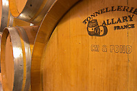 "Oak barrels marked with the cooper's name (Tonnellerie Allary) and ""CM & Fond"". CM means Chauffe Moyenne (medium toasting of the interior of the barrique) and ""Fond"" signifies the the flat end piece has also been toasted (le fond) which is unusual.  Chateau de Pressac St Etienne de Lisse  Saint Emilion  Bordeaux Gironde Aquitaine France"