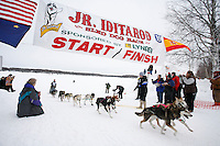 Sunday February 28, 2010   Merrisa Osmar crosses the finish line to take 1st place duirng the 2010 Junior Iditarod . Willow , AK
