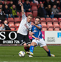 Pars' Andrew Geggan and Stranraer's Sean Winter challenge for the ball.