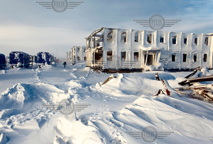 Workers from oil and gas exploration company Bashneft arrive at a camp abandoned and reclaimed by the snow by a rival company in the Russian Arctic. /Felix Features