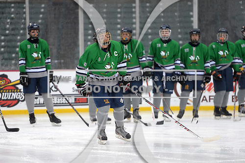 Notre Dame Fighting Irish of Batavia forward Mason Versage (9) during introductions before a varsity ice hockey game against the Brockport Blue Devils during the Section V Rivalry portion of the Frozen Frontier outdoor hockey event at Frontier Field on December 22, 2013 in Rochester, New York.  (Copyright Mike Janes Photography)