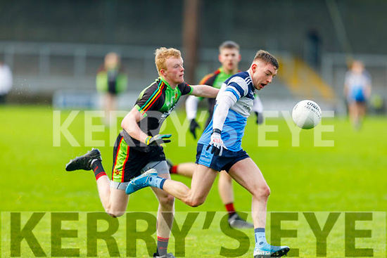 Conor Byrne of  IT Tralee on a run as Conor Doyle of Carlow IT tries to rob possession, in the Sigerson Cup R1 football game in Austin Stack Park on Sunday.