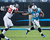 The Carolina Panthers defeated the Atlanta Falcons 34-10 in an inter-division rivalry played in Charlotte, NC at Bank of America Stadium.  Carolina Panthers running back Jonathan Stewart (28), Atlanta Falcons middle linebacker Akeem Dent (52)