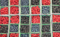Raspberries, blackberries, and blueberries. California fruit stand