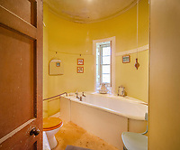 """BNPS.co.uk (01202) 558833. <br /> Pic: KnightFrank/BNPS<br /> <br /> Pictured: Bathroom. <br /> <br /> A castle that was burnt down by a pirate, involved in the English Civil War and has been in the same family for five centuries is on the market for offers over £650,000.<br /> <br /> Kilberry Castle, which dates back to the 15th century, has an incredible history and still has a wealth of original features including a 288-year-old mausoleum.<br /> <br /> It sits in 21 acres of land on the Scottish west coast, with stunning views over Kilberry Bay and out to the islands of Islay, Jura and Gigha.<br /> <br /> The four-storey tower house now needs a buyer """"with deep pockets and great imagination"""" to carry out a complete refurbishment but it has a lot of potential."""