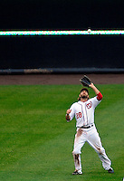 31 March 2011: Washington Nationals outfielder Jayson Werth pulls in a fly ball against the Atlanta Braves at Nationals Park in Washington, District of Columbia. The Braves shut out the Nationals 2-0 on Opening Day to start the 2011 Major League Baseball season. Mandatory Credit: Ed Wolfstein Photo
