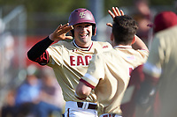 Boston College Eagles pinch runner Jake Alu (1) high fives teammates after scoring what would be the game winning run in the top of the ninth inning during a game against the Central Michigan Chippewas on March 3, 2017 at North Charlotte Regional Park in Port Charlotte, Florida.  Boston College defeated Central Michigan 5-4.  (Mike Janes/Four Seam Images)