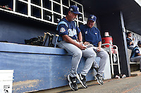 Corpus Christi Hooks manager Keith Bodie (11) and pitching coach Gary Ruby (21) look over game notes during a rain delay against the NW Arkansas Naturals on May 26, 2014 at Arvest Ballpark in Springdale, Arkansas.  NW Arkansas defeated Corpus Christi 5-3.  (Mike Janes/Four Seam Images)