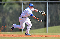 South Dakota State JackRabbits first baseman Aaron Machbitz (33) flips the ball to the pitcher covering during a game against the Georgetown Hoyas at South County Regional Park on March 9, 2014 in Port Charlotte, Florida.  Georgetown defeated South Dakota 7-4.  (Mike Janes/Four Seam Images)