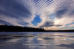 Dramatic stratocumulus undulatus clouds form over Lower Lake at Promised Land State Park, Pennsylvania in early February