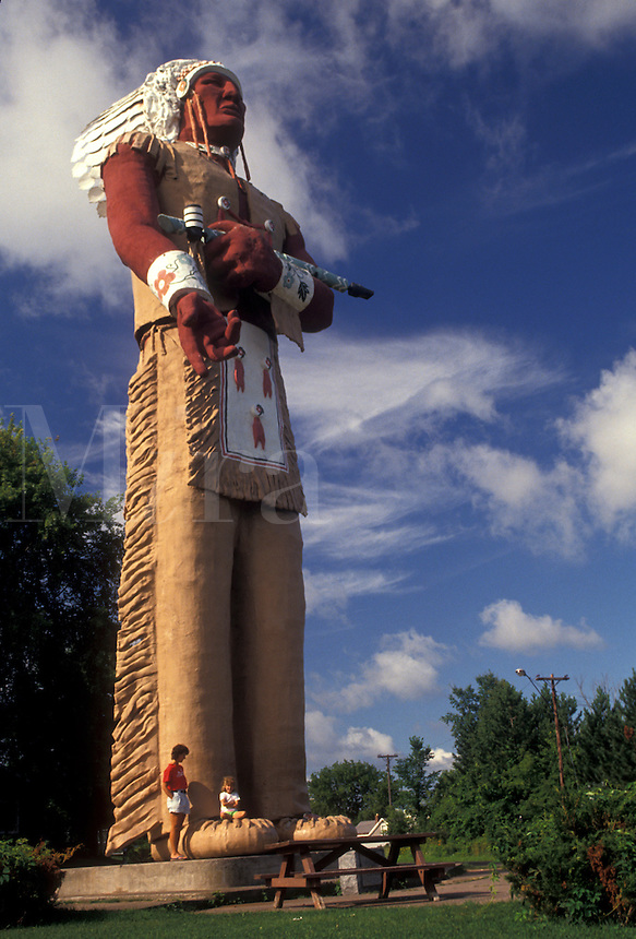 AJ2847, Hiawatha, indian, Upper Peninsula, U.P., Michigan, Mother and daughter stand next to the 53 foot high towering statue of Hiawatha in Ironwood in the state of Michigan.