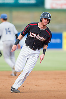 Danny Hayes (32) of the Kannapolis Intimidators hustles towards third base against the Asheville Tourists at CMC-NorthEast Stadium on July 13, 2014 in Kannapolis, North Carolina.  The Tourists defeated the Intimidators 8-2.  (Brian Westerholt/Four Seam Images)
