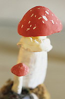 This small reproduction of an Amanita Muscaria made of ceramic is strikingly realistic