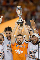 Houston Dynamo team captain Wade Barrett lifts the Western Conference trophy. The Houston Dynamo defeated the Kansas City Wizards 2-0 at Robertson Stadium in Houston, TX on November 10, 2007 to capture the MLS Western Conference Championship. The Houston Dynamo will take on the New England Revolution in the MLS Cup Final on November 18, 2007 at RFK Stadium in Washington D.C.