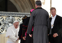 Papa Francesco saluta alcuni prelati al termine dell'udienza generale del mercoledi' in Piazza San Pietro, Citta' del Vaticano, 22 aprile 2015.<br /> Pope Francis greets some prelates at the end of his weekly general audience in St. Peter's Square at the Vatican, 22 April 2015.<br /> UPDATE IMAGES PRESS/Riccardo De Luca<br /> <br /> STRICTLY ONLY FOR EDITORIAL USE