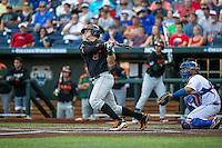David Thompson (8) of the Miami Hurricanes bats during a game between the Miami Hurricanes and Florida Gators at TD Ameritrade Park on June 13, 2015 in Omaha, Nebraska. (Brace Hemmelgarn/Four Seam Images)