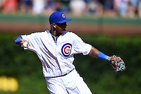 Chicago Cubs shortstop Starlin Castro (13) throws to first during a game against the Milwaukee Brewers on August 14, 2014 at Wrigley Field in Chicago, Illinois.  Milwaukee defeated Chicago 6-2.  (Mike Janes/Four Seam Images)